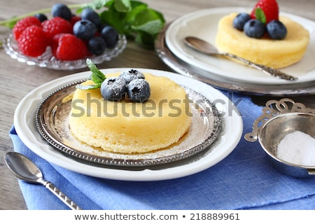 Delicious lemon pudding cake served with berries Stock photo © Melnyk