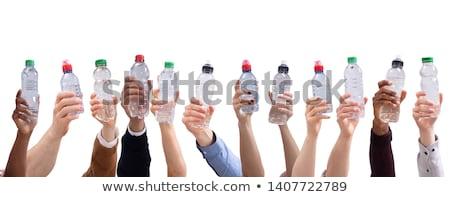 Különböző emberek tart víz üvegek csetepaté Stock fotó © AndreyPopov