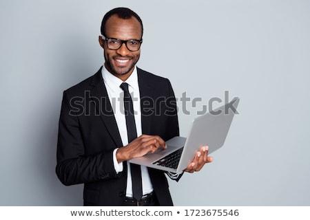 Stok fotoğraf: Genç · işadamı · dizüstü · bilgisayar · yakışıklı · gülen