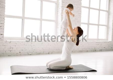 mother and baby gymnastics yoga stock photo © lopolo