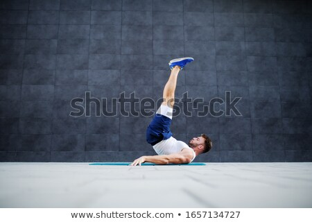 Fitness and Sport, Man Doing Candlestick Exercise Stock photo © robuart
