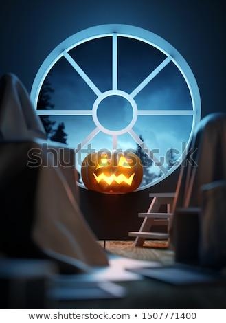 Pumpkin Lantern In a Attic Window Stock photo © solarseven