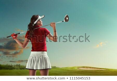 Feminino jogador de golfe pôr do sol mulher verde olhando Foto stock © lichtmeister