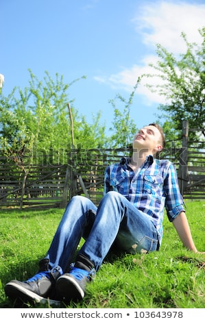 young teen boy looking out of a fence Stock photo © Lopolo
