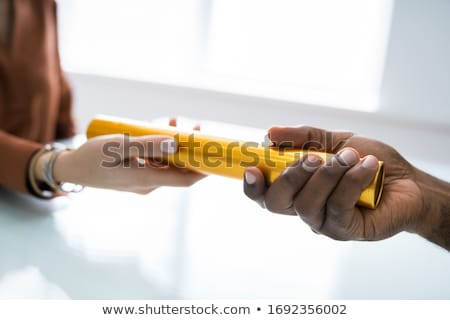 Passing Golden Relay Baton To Other Person Stock photo © AndreyPopov