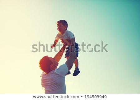 Boldog örömteli apa baba naplemente szeretet Stock fotó © Lopolo