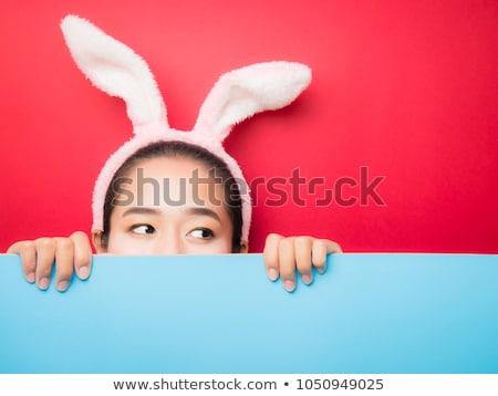 happy girl wearing easter bunny ears headband Stock photo © dolgachov