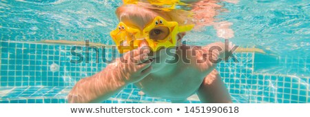 Dziewczynka pływać podwodne basen banner długo Zdjęcia stock © galitskaya