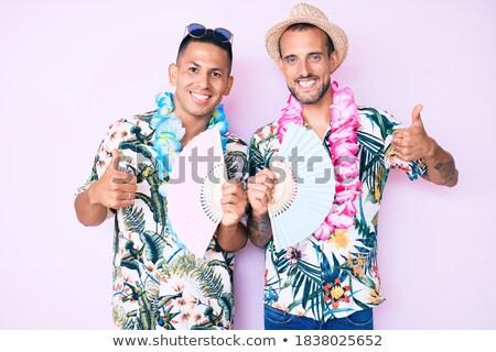 Gelukkig paar zonnebril tonen handteken Stockfoto © dolgachov