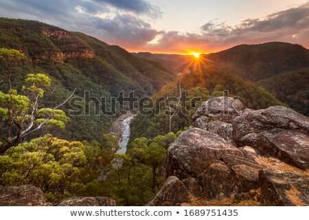 Vadi güneş su gün batımı doğa dağ Stok fotoğraf © lovleah