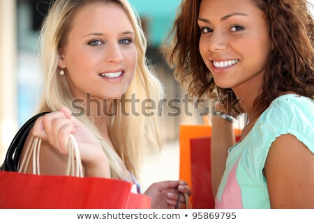two 20 years old girls, a blonde and a metis doing shopping Stock photo © photography33