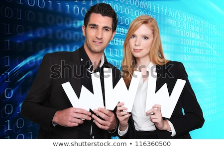 Couple holding the letters WWW Stock photo © photography33