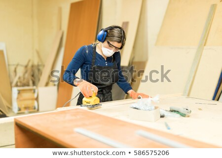portrait of young carpenter with sander machine Stock photo © photography33