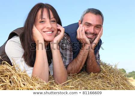 Farmer and wife laying in hay Stock photo © photography33