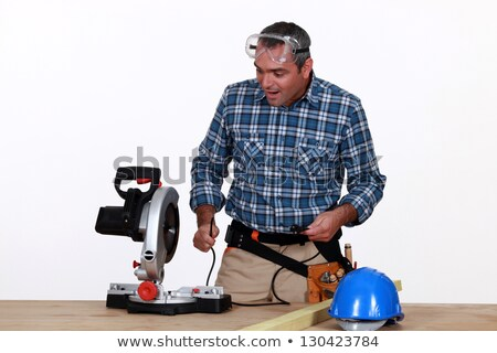 Astonished man looking at a mitre saw Stock photo © photography33
