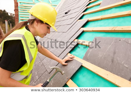 Female builder with hammer Stock photo © photography33