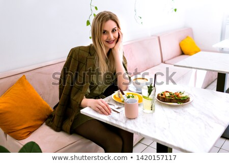 Beautiful blonde woman in fancy dress in luxury interior. Stock photo © Pilgrimego