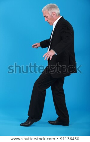 a mature businessman walking on a invisible line stock photo © photography33