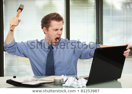 Man threatening computer with hammer Stock photo © photography33