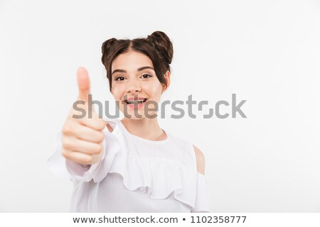 Amused woman gesturing double thumbs up stock photo © stockyimages