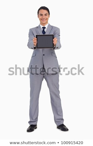Man in a suit showing a tactile tablet screen against white background stock photo © wavebreak_media
