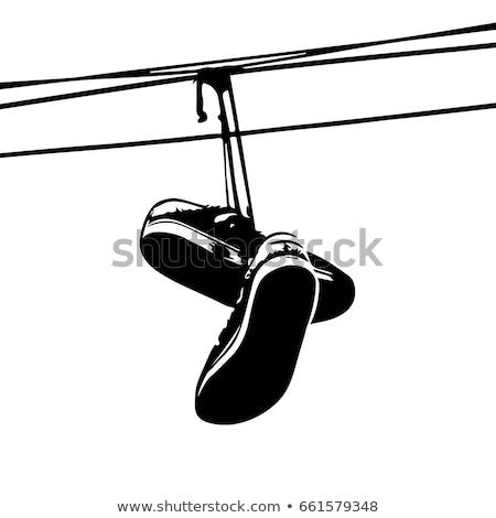 Sportcipők akasztás telefon vonal városi fiatalság Stock fotó © leedsn