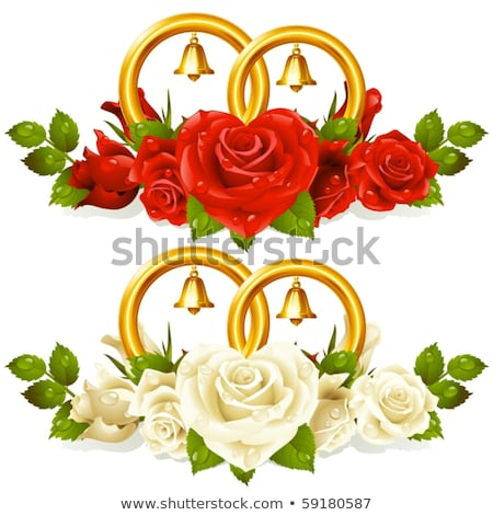 Wedding rings on a posy of fresh red roses stock photo © jrstock