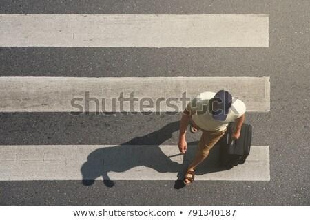 Asya adam yürüyüş dikkatlice dengelemek Stok fotoğraf © szefei