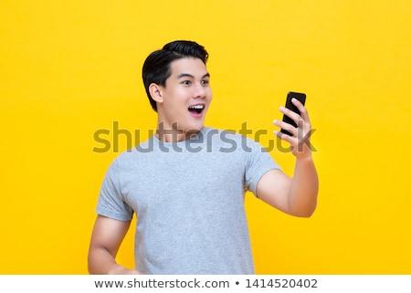 Shocked Asian man Stock photo © szefei