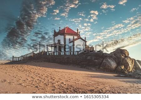 Kapel Portugal silhouet zonsondergang strand water Stockfoto © dinozzaver