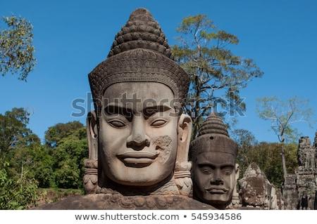 Angkor Thom (ancient royal city) gate. Siem Reap, Cambodia. Stock photo © tuulijumala