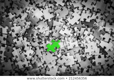 psychological concept on green puzzle pieces stock photo © tashatuvango