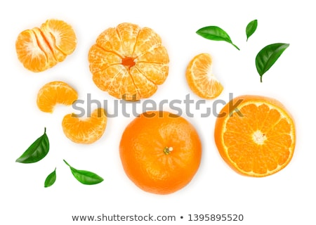 Ripe tangerine or mandarin with slices on white Stock photo © bloodua