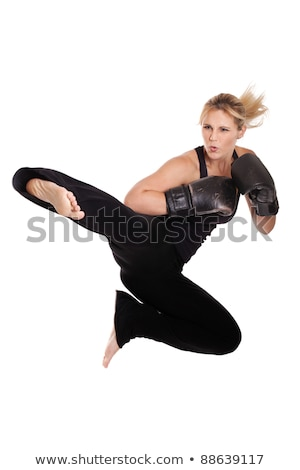 Athletic woman performing a flying side kick Stock photo © pxhidalgo