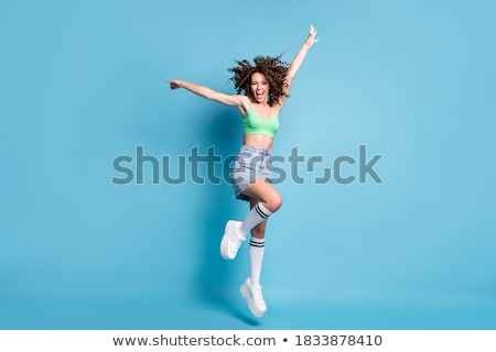 zafer · atlamak · kadın · atlama · sevinç - stok fotoğraf © reicaden