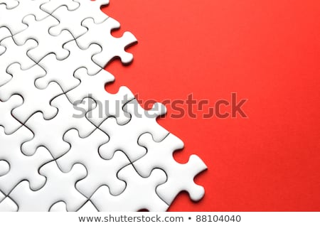 Incompleted white puzzle on red background Stock photo © leungchopan