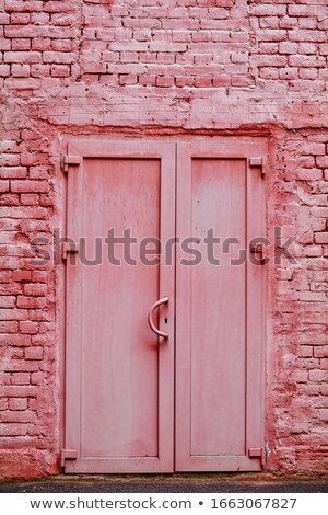 Red painted door with locks and brickwork Stock photo © jenbray