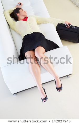 Tired Woman Lying On Sofa After Returning From Work Stock photo © monkey_business