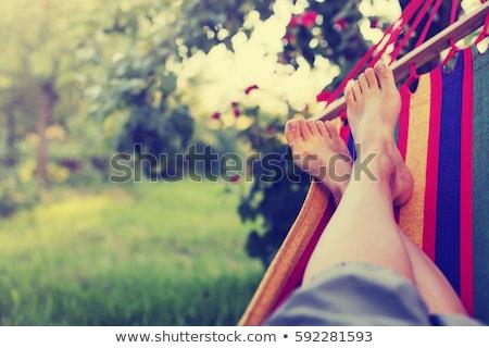 Megnyugtató függőágy közelkép mezítláb férfi égbolt Stock fotó © nito