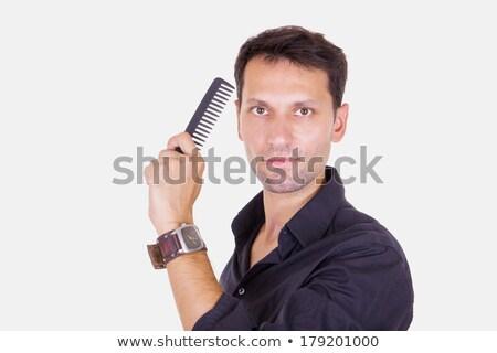 male barber catching comb Stock photo © feelphotoart