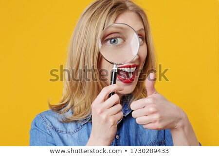 Pretty young blond woman with blue eyes Stock photo © dash
