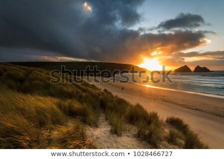 Stockfoto: Spectaculaire · zonsondergang · dramatisch · zee · zand · rock