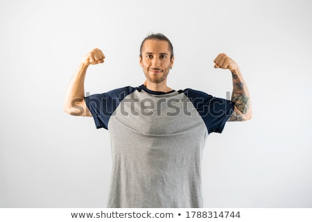 Attractive young fashion man pulling his sleeve. Stock photo © feedough