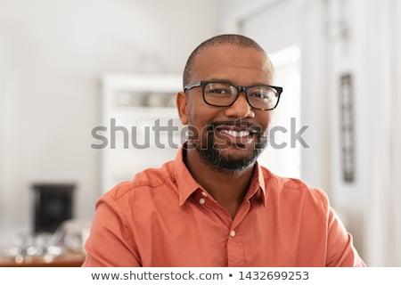 Afrikai férfi fiatal gyönyörű pózol izolált Stock fotó © hsfelix