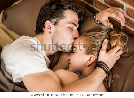 caucasian couple in love on the bed stock photo © deandrobot