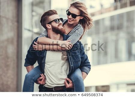 Jóképű szakállas fiatalember mosoly karizmatikus visel Stock fotó © juniart