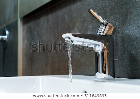 Modernes robinet d'eau acier inoxydable fini eau salle de bain Photo stock © ziprashantzi
