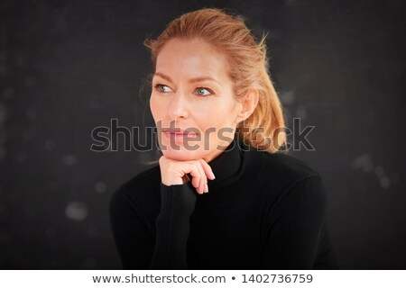 Attractive middle-aged woman deep in thought Stock photo © ozgur