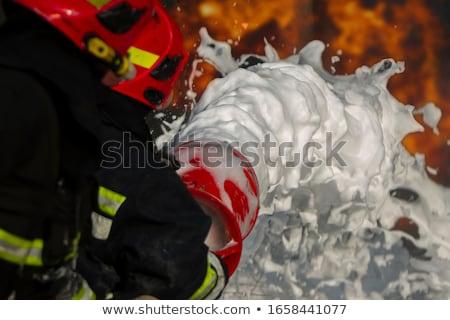 Firemen spray firefighting foam Stock photo © wellphoto