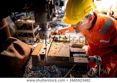 factory worker is working on lathe machine stock photo © voysla